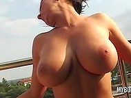 Pleasant brunette from Poland takes off clothes on the balcony and demonstrates big natural tits 10
