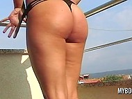 Pleasant brunette from Poland takes off clothes on the balcony and demonstrates big natural tits 8