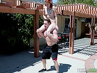 Pumped bull uses fetching girl with red hair as barbell and they have oral sex