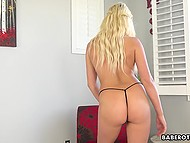 Light-haired chick with tanned body is keen to show how she satisfies pussy in solo video