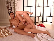 Asian masseuse in red robe turns guy on and enjoys his hard dick inside pierced pussy