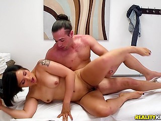 Asian wench gives client handjob to make him cum after cock riding and spoons position