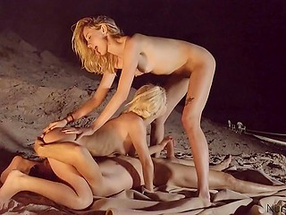 Attractive blonde girls wait for nightfall to practice sex with common guy by the fire