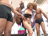 Black men masturbate hairy pussy of Japanese MILF after she blows their cocks