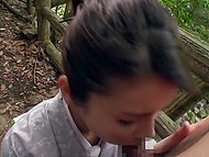 Winsome Japanese girl in kimono shows wonderful ass on wooden bridge and gives blowjob 10