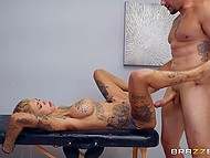 Masseuse with inked body gives up and allows new client Jmac to drill her pussy hard on the massage table