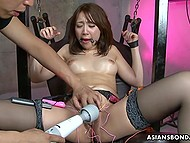 Guys bound Japanese chick in stockings and shove ball gag into mouth then focus on hairy pussy