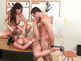 Art teachers Syren De Mer and Eva Notty share stud's manhood in empty classroom