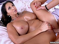 Dazzling Ava Addams with massive oiled hooters enjoys young dick in the bedroom