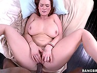 Redhead with smokin' hot natural boobs fools around with black man who cums in her mouth