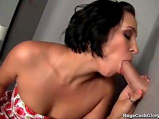 Brunette MILF facialized after sucking erect phallus in toilet through special gloryhole