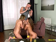 Two chicks for horny boy filming females fooling around and making them suck him together