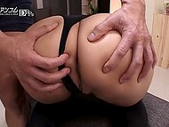 Guy can't deny himself pleasure of playing with wonderful ass of Japanese girl in fishnets and boots 9