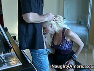 Hot blonde music teacher with appetizing tits in a violet dress has sex with student