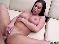 Nasty young woman Kendra Lust takes dong inside of trimmed vagina and stimulates clitoris with hand