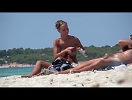 Awesome Croatian love fondles body and creams partners skin on a public beach being caught on camera 11