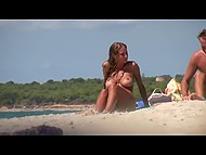 Awesome Croatian love fondles body and creams partners skin on a public beach being caught on camera 4
