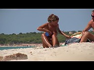 Awesome Croatian love fondles body and creams partners skin on a public beach being caught on camera 6