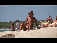 Awesome Croatian love fondles body and creams partners skin on a public beach being caught on camera 8