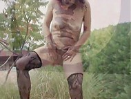 Mature minx in stockings stretches unshaved pussy with fingers and goes to piss outdoors 11