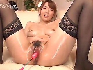 Man masturbates hairy pussy of Japanese girl in stockings using vibrators and that's why she moans