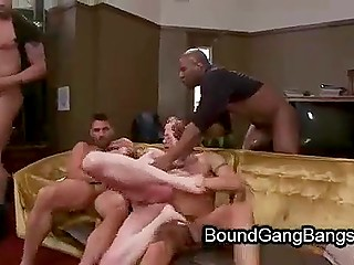Woman with tattoos is in a good mood and doesn't know that guys will fuck her hard in BDSM porn video