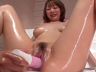 Guy decides to oil nice breasts of Japanese girl before masturbates hairy pussy