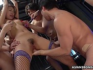 Asian girl moans while cocks are moving in and out of her mouth and voracious twat 5