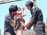 Two Japanese perverts dominate over helpless cutie outdoors by using some sex toys 7