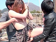 Two Japanese perverts dominate over helpless cutie outdoors by using some sex toys 8