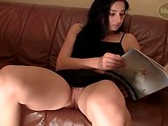 Dark-haired girl decides to gladden boyfriend and takes off pink panties to show smooth pussy on camera