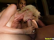 Adorable MILF sucks cock and enjoys powerful frictions of partner in a moving car 10
