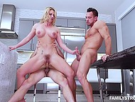 Two handsome neighbors have hard group sex with busty MILF on the kitchen table