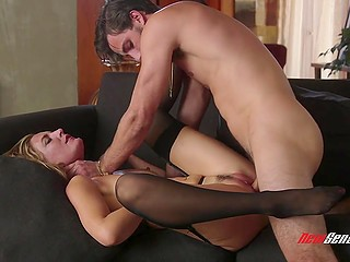 Sexy blonde in stockings is talking to her husband while she is fucked by a beautiful young lover