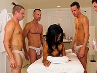 Four professional massage therapists give a relaxing massage to beautiful Latina and excite her 4