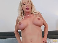 Attractive blonde MILF in latex with blonde hair enjoys having beautiful sex with young dude 9