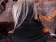 Beautiful blonde playfully poses and masturbates in skeleton costume on Halloween 4