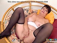 Short-haired brunette granny spends free time by playing solo with purple sex toy 5