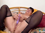 Short-haired brunette granny spends free time by playing solo with purple sex toy 8