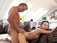 Mutual masturbation of young brunette and older boss turned into blowjob and sex on the sofa 8