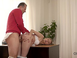Tender-hearted man in red sweater lets soaked blonde come in for warming and treats her with cock