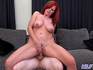 Partner cums on beautiful tits of Swedish mature with red hair but she doesn't leave him alone and rides cock