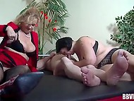 Brunette bonked by fat guy under control of experienced German sex diva taking a part in threesome