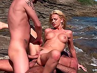 Naughty men not only tanning on the rocky beach but uniting penises with acquainted MILF's holes