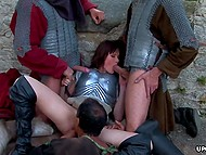 Three hungry women knights caught fighting a girl, which they fuck until the evening