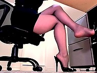 During operation, the playful Secretary willingly shows legs in pantyhose on hidden camera