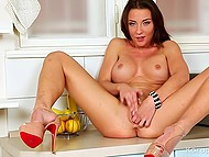 Belgian minx Julie Skyhigh masturbates on the kitchen countertop and can use a banana any moment 6