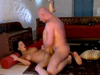 Bald man fucks amazing tattooed brunette on the floor
