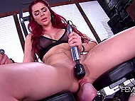 Redhead mistress sits on her dominated man's and takes out vibrator for more action