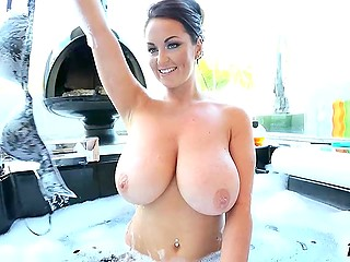 British centerfold Sarah Nicola Randall combines taking foam bath with huge tits demonstration